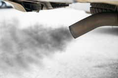 Exhaust from black car , air pollution concept