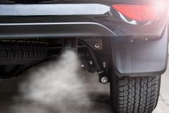 Exhaust from black car , air pollution concept.  royalty free stock image