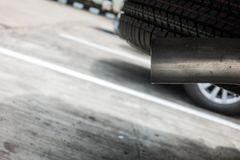 Exhaust from black car , air pollution concept stock photography