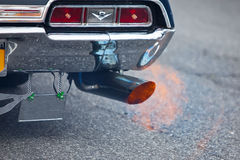 Exhaust Blows. Pipe exhaust of a car - blowing out the flame royalty free stock images