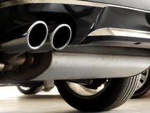 Exhaust of car in car dealer shop closeup Royalty Free Stock Photo
