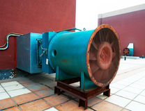 Exhaust fan and exhaust system. A large electric motor to drive the fan exhaust gases on the shadow stack stock image