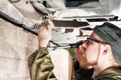 Exhaust Fix. Mechanic Under Car Installing Exhaust Pipe Stock Photo