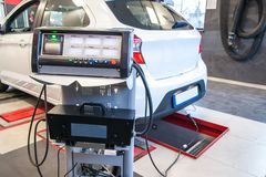 Exhaust gas measurement at a diagnostic station in a passenger car. In service stock photos