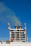Exhaust gas from the smokestack of a ship Stock Images