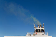 Exhaust gas from the smokestack of a ship Royalty Free Stock Image