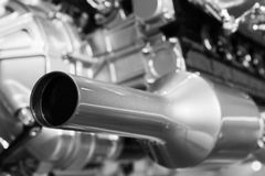Exhaust and motor parts, sport car V12 engine. Fragment, closeup photo with selective focus Stock Photo