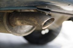 Exhaust of a passenger car Royalty Free Stock Images