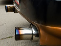 Exhaust pipe. The chromeplated exhaust pipes of the sports car Stock Photos