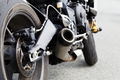 Exhaust Pipe And Rear Wheel Of Motocicle Royalty Free Stock Photos