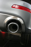 Exhaust pipe and back part of car Royalty Free Stock Photos