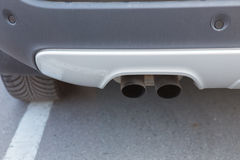 Exhaust pipe and back part. Of new car Royalty Free Stock Photography