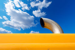 Exhaust Pipe on Blue Sky Royalty Free Stock Photography