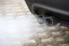 Exhaust pipe of a car blowing Royalty Free Stock Photography