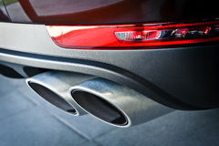 Exhaust pipe. Close up of a car dual exhaust pipe Stock Photo
