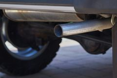 Exhaust Pipe Closeup. Exhaust pipe of a car, from below Royalty Free Stock Photography