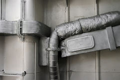 Exhaust Pipe. Detail of an old exhaust pipe with asbestos cover.(Ship engine room Stock Photos
