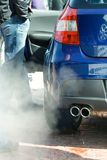Exhaust pipe and fumes. Exhaust pipe of the car and polluting fumes Stock Images