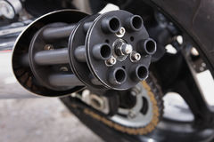 Exhaust pipe of a motorcycle. In the form of a machine gun Royalty Free Stock Photos