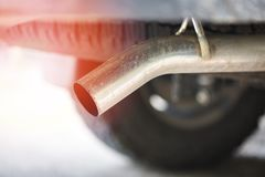 Exhaust pipe on pickup truck car close up / Car pollution concept stock image