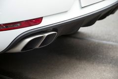 Exhaust pipe. Two exhaust pipes with a large SUV Royalty Free Stock Photography