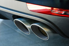 The exhaust pipe of the vehicle. Close up of a car dual exhaust pipe Stock Images