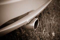 Exhaust pipe in a yellow sports car. Exhaust pipe in the yellow sports car Stock Photography