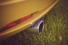 Exhaust pipe in a yellow sports car. Exhaust pipe in the yellow sports car Royalty Free Stock Photo