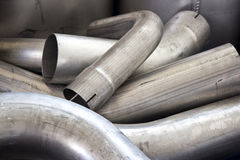 Exhaust pipes. Metalic exhaust pipes as a background Stock Photo