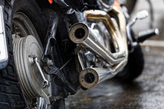 Exhaust Pipes And Rear Wheel Of Motocicle Stock Image