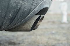 Important components of the car parts. Exhaust pipes leaving the car muffler royalty free stock photography