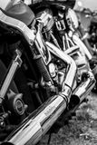 Exhaust pipes of a motorcycle Harley-Davidson. Stock Photos
