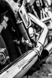 Exhaust pipes of a motorcycle Harley-Davidson. Royalty Free Stock Images