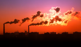 Exhaust smoke / Air pollution / Sunrise. / Silhuette / Color Toned Stock Photo