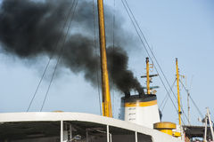 Exhaust smoke from a ship smoke stack Stock Image