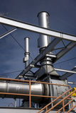 Exhaust stacks. Two exhaust stacks and associated equipment mounted on a steel frame work Royalty Free Stock Image
