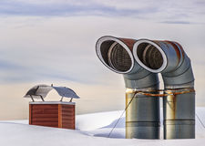 Exhaust tubes in snow royalty free stock photography