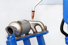 Exhaust welding. Catalytic converter and exhaust parts welding process Royalty Free Stock Photos