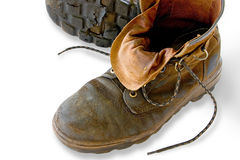 Exhausted. Tired pair of work boots at the end of a hard day. With clipping path Stock Image