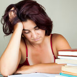 Exhausted adult hispanic student Royalty Free Stock Photo