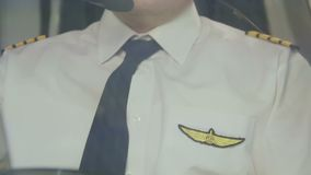 Exhausted airline captain maneuvering plane, hard work, prestigious profession. Stock footage stock footage