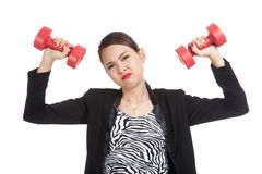 Exhausted Asian business woman with dumbbells Stock Photography