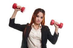Exhausted Asian business woman with dumbbells. Royalty Free Stock Photo