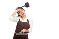 Exhausted Asian girl cook with frying pan Royalty Free Stock Image