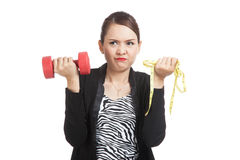 Exhausted  Asian woman with dumbbells and measuring tape Stock Photography