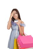 Exhausted Asian woman fed up hold shopping bags and credit card Stock Photography