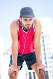 Exhausted athlete leaning forward after an effort Royalty Free Stock Photos