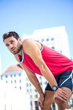 Exhausted athlete leaning forward after an effort Royalty Free Stock Image