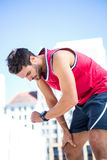 Exhausted athlete looking at his stopwatch Stock Image