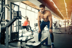 Exhausted athlete working out Stock Photos